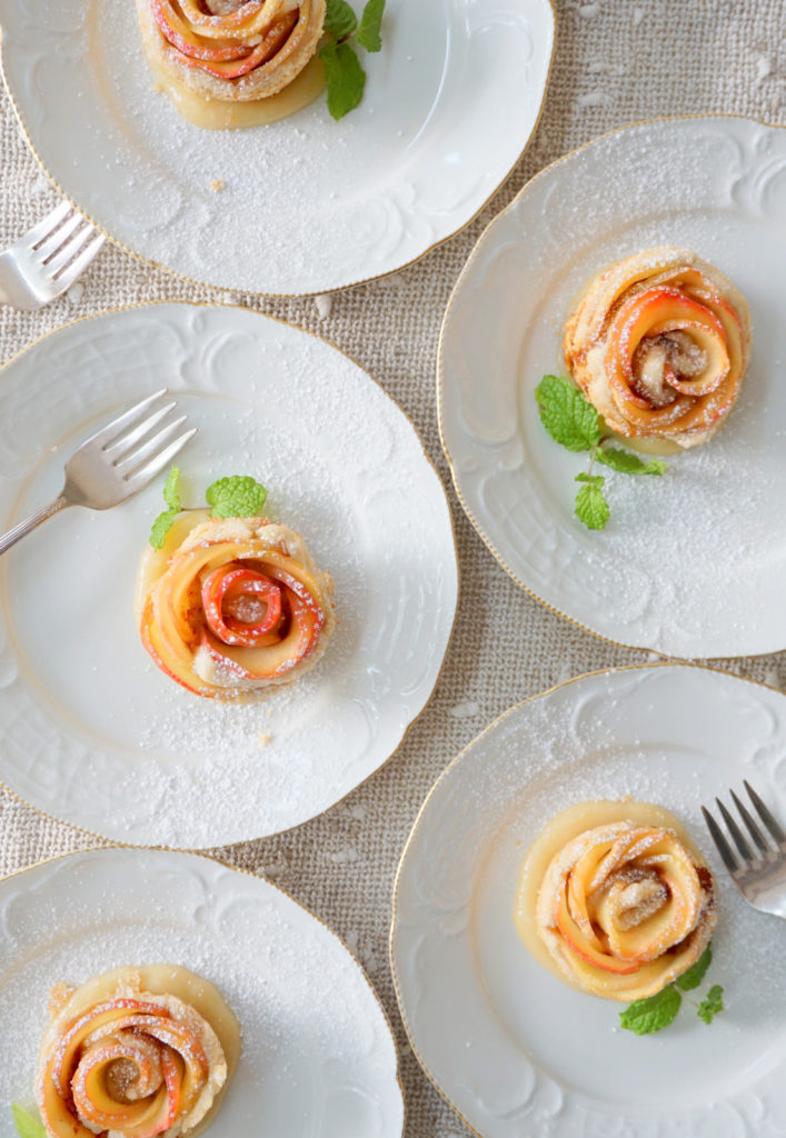 Apple Blossoms baked in a buttery pastry and drenched in rum caramel sauce