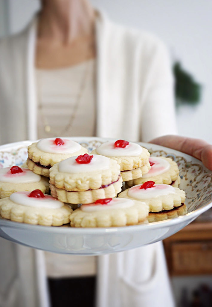 Classic Empire Cookies for the Holiday. Filled with raspberry jam, toped with almond icing and a cherry on top!